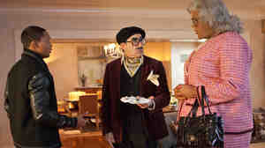 In Madea's Witness Protection, George Needleman (Eugene Levy, center) is put in witness protection with Madea (Tyler Perry, right) after he discovers he's the fall man for a Ponzi scheme.