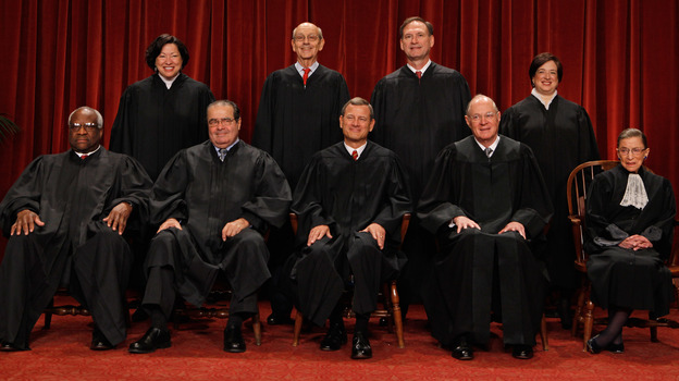 The U.S. Supreme Court justices — (first row, from left) Clarence Thomas, Antonin Scalia, Chief Justice John Roberts, Anthony Kennedy, Ruth Bader Ginsburg, (back row) Sonia Sotomayor, Stephen Breyer, Samuel Alito and Elena Kagan — pose at the Supreme Court in 2010. (Getty Images)