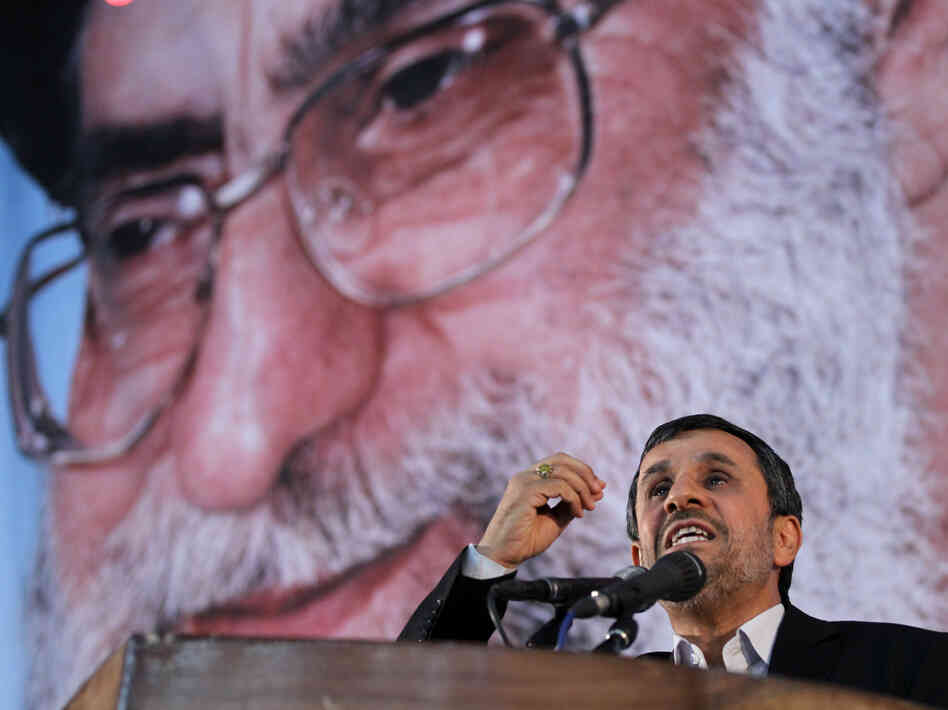 Iranian President Mahmoud Ahmadinejad, shown speaking June 2 under a portrait of Iran's supreme leader, Ayatollah Ali Khamenei, has said Iran will not bow to sanctions.