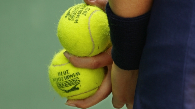 Wimbledon's ball boys and girls must remain completely still and silent during game play. (AP)