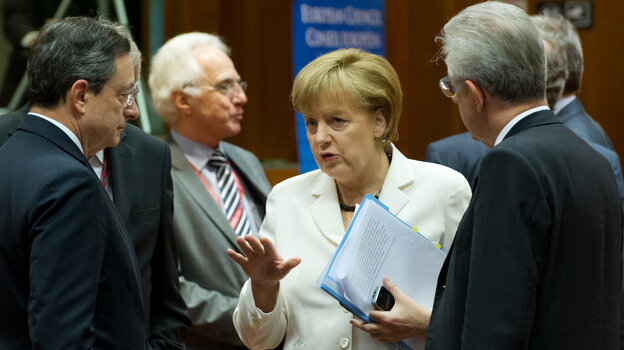 German Chancellor Angela Merkel talks with European Central Bank President Mario Draghi (left) and Italian Prime Minister Mario Monti (right) during the summit of European leaders in Brussels.