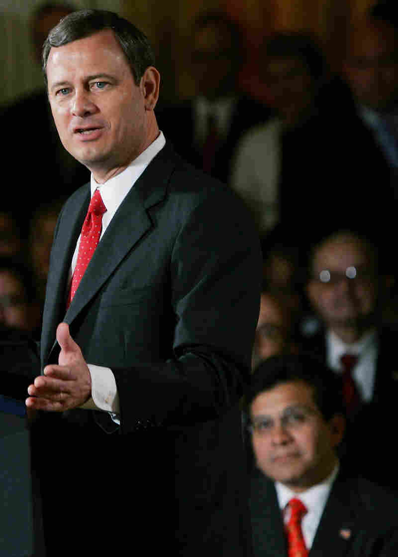 Sept. 29, 2005: Then-Attorney General Alberto Gonzales, at lower right, watches as Supreme Court Chief Justice John Roberts speaks after being sworn in.