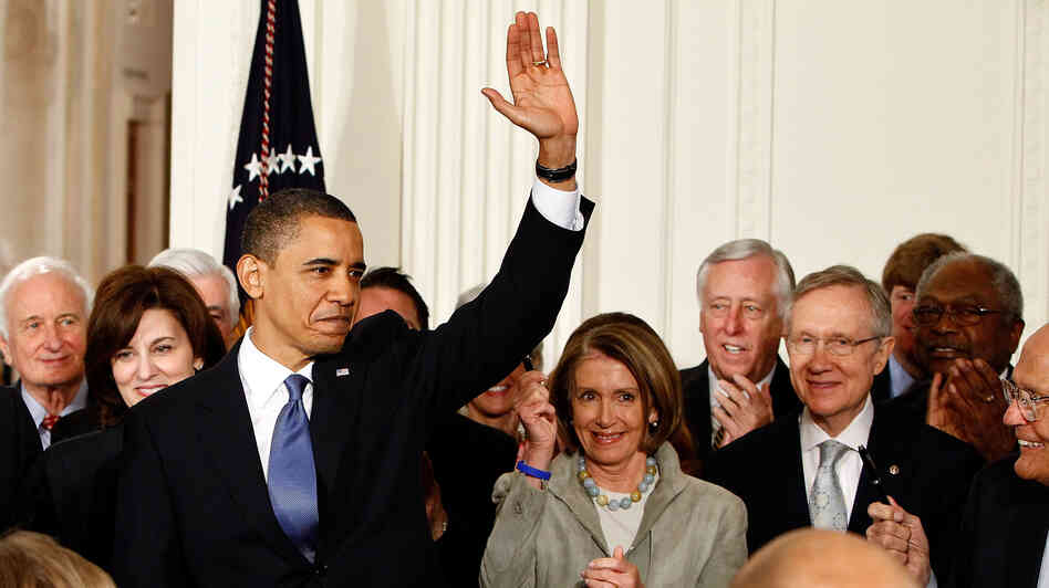President Obama waves after signing the Affordable Care Act at the White House on March 23, 2010.