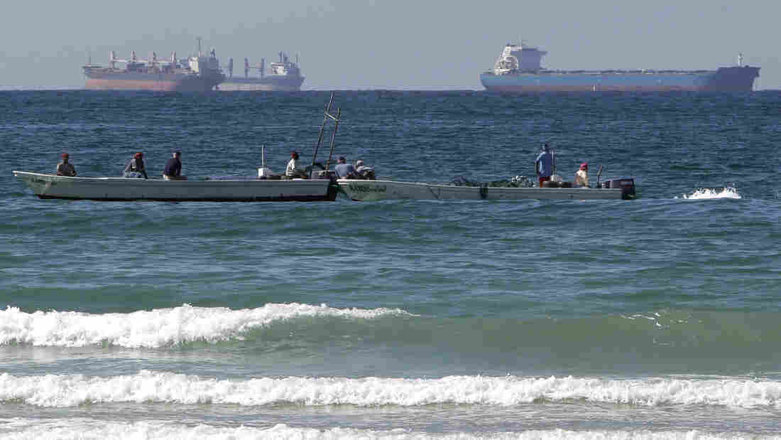 European countries have agreed to stop importing Iranian oil as of Sunday. This could make it harder for Iran to find markets for its crude. Iran has been filling up tankers off its coast, but analysts say it could run out of storage capacity. This photo shows oil tankers off Ir