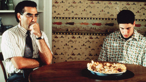 Eugene Levy with Jason Biggs and the now-infamous defaced pie in one of his most popular recurring roles as Jim's dad in American Pie.