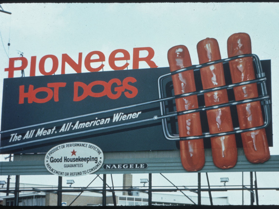 These Pioneer hot dogs look like they are going to jump off of this 1965 billboard and into your mouth. (Outdoor Advertising Association of America, Inc., via Duke University)
