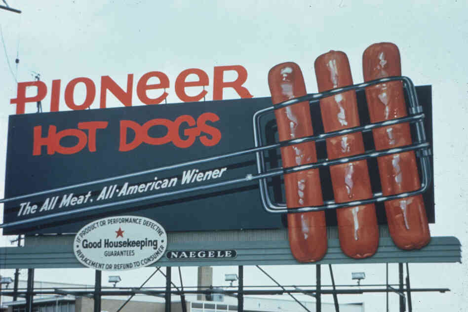These Pioneer hot dogs look like they are going to jump off of this 1965 billboard and into your mouth.
