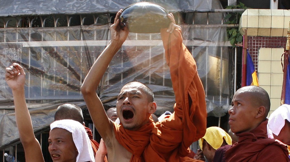 A monk waves his alms bowl upside down in defiance of a threat to send troops to end anti-junta protests in Yangon on Sept. 25, 2007, during the country's monk-led Saffron Revolution.