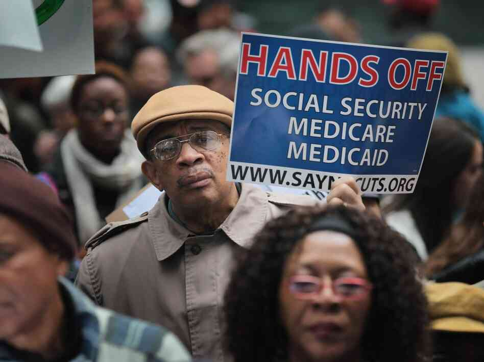Demonstrators protest against cuts to federal safety net programs, including Social Security, Medicare, and Medicaid on November 7, 2011 in Chicago, Ill. The Supreme Court's decision on the Affordable Care Act yesterday opens the door for states to refuse to expand their medicaid programs.