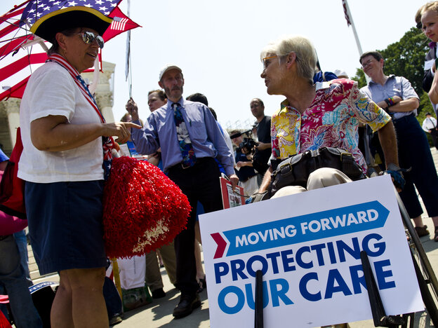 Susan Clark (left) argues with another protester about the Affordable Care Act outside the U.S. Supreme Court on Thursday.
