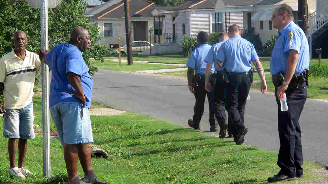 Sgt. Miro Brekalo talks with residents in New Orleans' Gentilly neighborhood, as other officers walk their beat. Their goal isn't only to stop crime; it's also to connect with citizens who are often reluctant to report crimes.