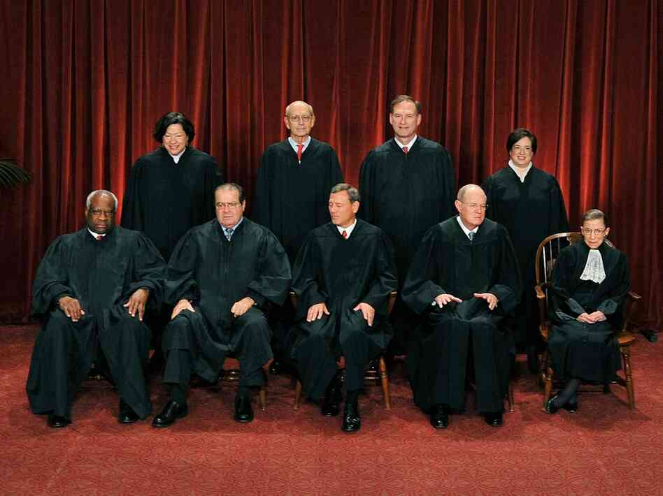 Members of the Supreme Court sit for their official photo on October 8, 2010.