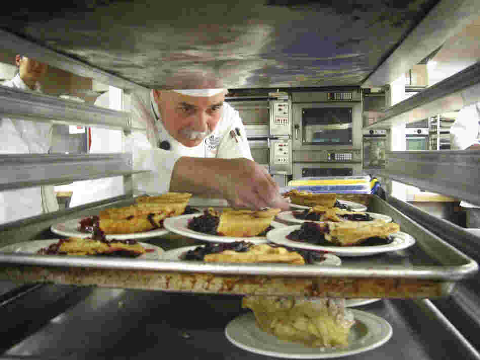CIA Instructor George Higgins checks the slices of pie made by students.