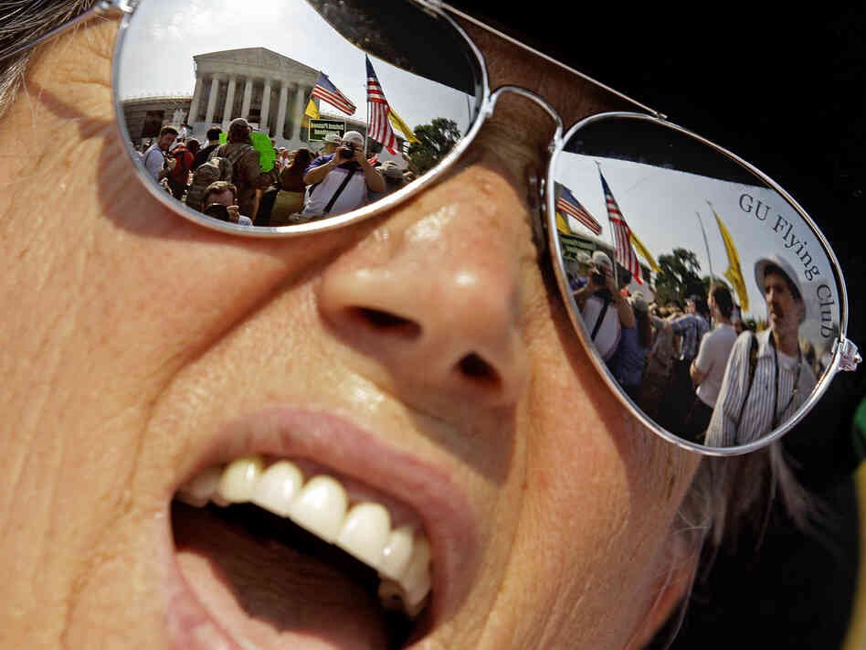 A demonstrator protests outside the the Supreme Court Thursday in Washington, D.C.