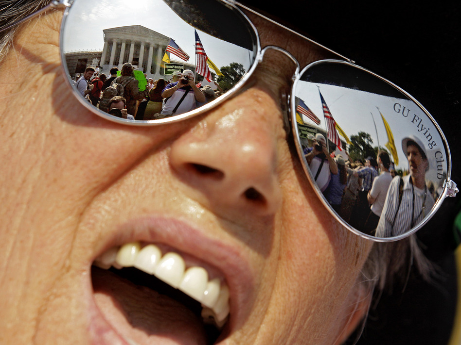 A demonstrator protests outside the the Supreme Court Thursday in Washington, D.C. (AP)