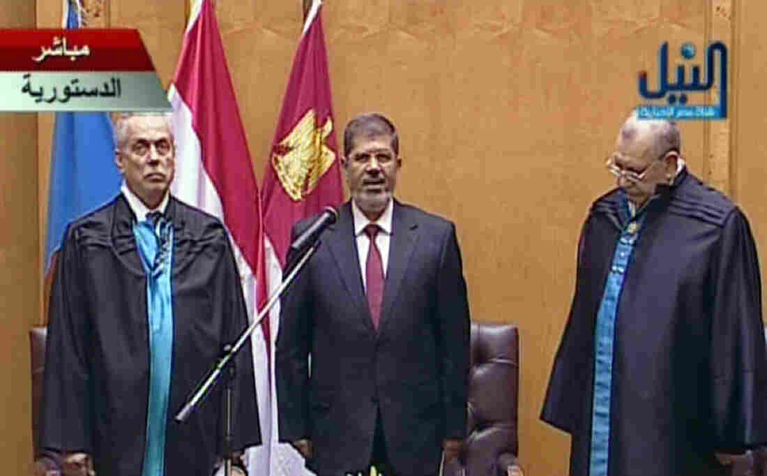 An image grab taken from Egypt's Nile TV shows Egyptian President Mohamed Morsi (center) taking the oath of office during the official swearing-in ceremony at the Constitutional Court in Cairo on Saturday.
