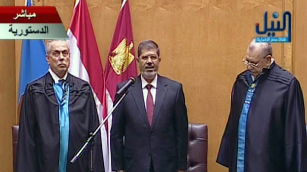An image grab taken from Egypt's Nile TV shows Egyptian President Mohamed Morsi (center) taking the oath of office during the official swearing-in ceremony at the Constitutional Court in Cairo on Saturday. (AFP/Getty Images)