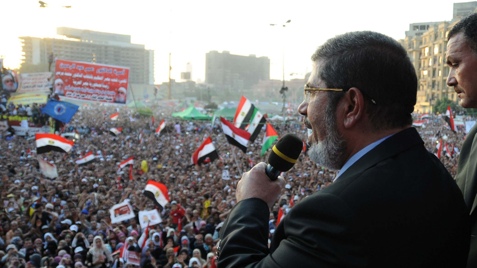In this handout picture made available by the Egyptian presidency, Egypt's Islamist president-elect Mohamed Morsi addresses tens of thousands of Egyptians in Cairo's iconic Tahrir Square on Friday. (AFP/Getty Images)