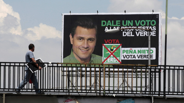 A man walks past a campaign sign for Enrique Pena Nieto, of the opposition Institutional Revolutionary Party. Mexicans vote for their next president on Sunday. (AP)