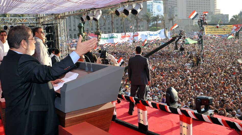The Egyptian Presidency released this image of Mohammed Morsi giving a speech to tens of thousands of people in Cairo's Tahrir Square on Friday. Morsi was sworn in as Egypt's president on Saturday. (EPA /Landov)