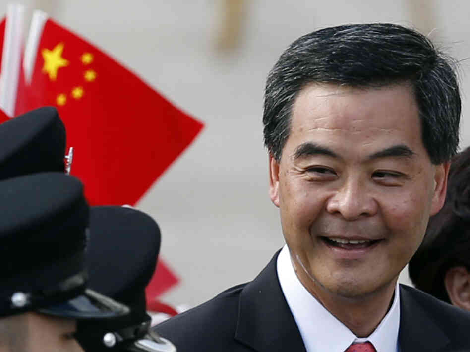 Hong Kong's new Chief Executive Leung Chun-ying attends the flag-raising ceremony to mark the 15th anniversary of the Hong Kong handover to China in Hong Kong Sunday.