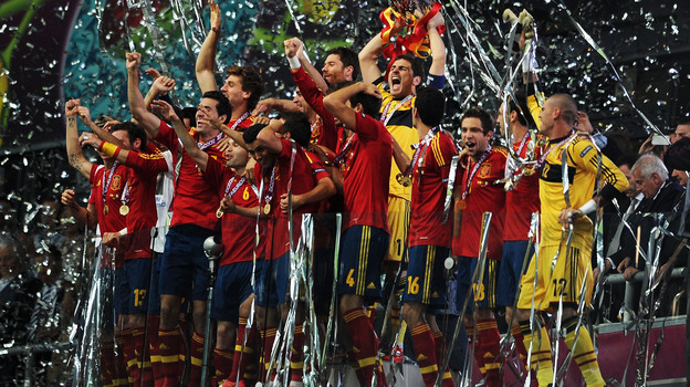 Iker Casillas (center) of Spain lifts the trophy as he celebrates following victory in the UEFA EURO 2012 final match between Spain and Italy at the Olympic Stadium on July 1, 2012 in Kiev, Ukraine.