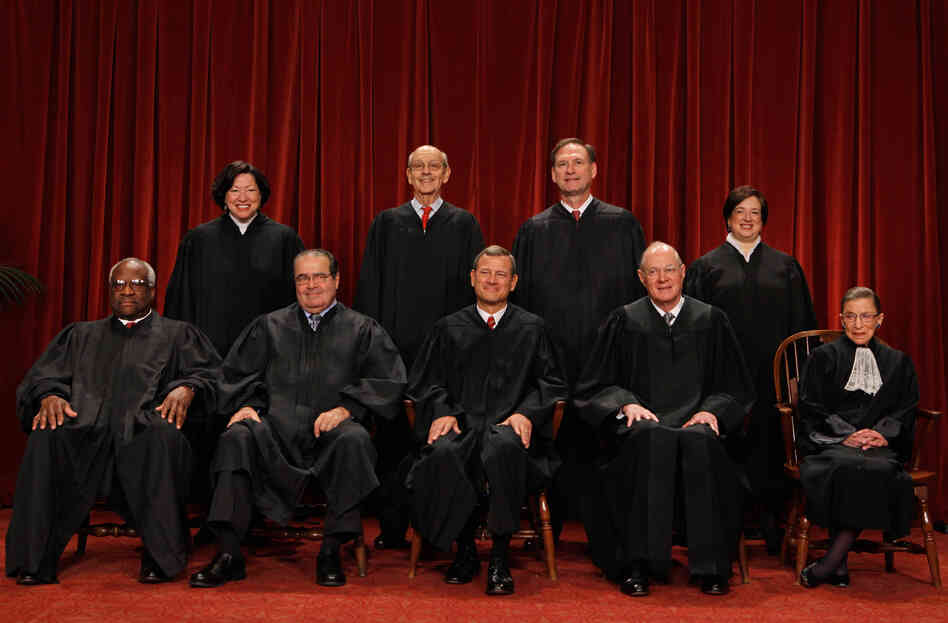 The U.S. Supreme Court justices (first row, from left) Clarence Thomas, Antonin Scalia, Chief Justice John Roberts, Anthony Kennedy, Ruth Bader Ginsburg, (back row) Sonia Sotomayor, Stephen Breyer, Samuel Alito and