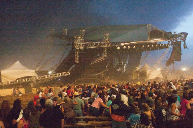 <strong>DRY MICROBURST: </strong>A stage collapses at the Indiana State Fair on Aug. 13, 2011, in Indianapolis just before the country duo Sugarland was to play. Seven people were killed and 58 injured.