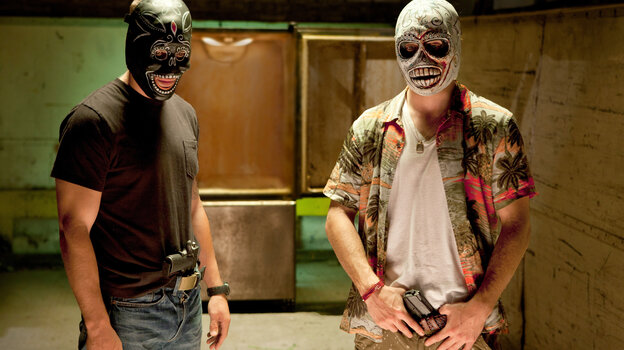 In Savages, two drug dealers — Chon (Taylor Kitsch, left), a former Navy SEAL, and Ben (Aaron Johnson), a pacifist — are forced to take up arms when they anger the head of a Mexican cartel.