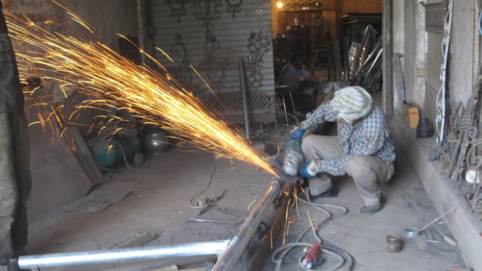 This welding shop in Kabul relies on a generator because the city power supply isn't reliable or powerful enough for the equipment. (NPR)