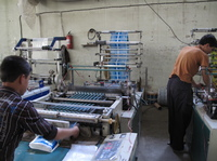The Omid Plastic Making Factory in Kabul manufactures plastic bags. Even though the industrial park where it's located was supposed to guarantee full power, the factory often relies on a generator.