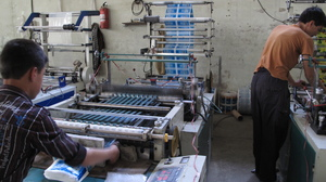 """The Omid Plastic Making Factory in Kabul manufactures plastic bags. Even though the industrial park where it's located was supposed to guarantee full power, the factory often relies on a generator. """"There is no industrial power for us. We are using the same power as normal people,"""" says factory manager Abdul Qadida Sozai."""