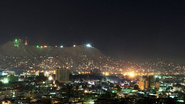 Afghanistan produces about half the power it currently uses and imports the other half from neighboring countries. But that total still doesn't meet the country's demands. This photo shows Kabul at night in January. (EPA/Landov)