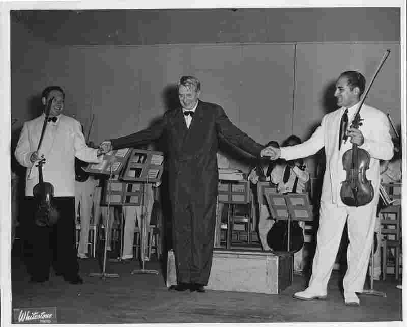 Undated: Conductor Charles Munch takes a bow with violinist Isaac Stern and BSO prinicipal violist Joseph de Pasquale.