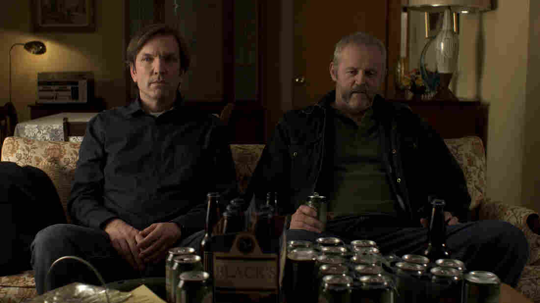 Robert (Martin Donovan, left), a writer in need of inspiration, sits with his uncultured kidnapper, Gus (David Morse), in Collaborator. Donovan also wrote and directed the film.