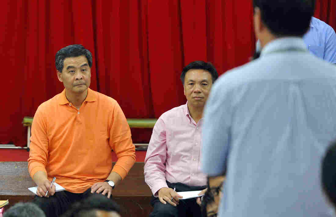 "New Hong Kong Chief Executive Leung Chun-ying visits a Welfare Advancement Association on Monday, a day after taking office. Leung vowed he would ""humbly"" listen to the public, but some critics branded him a lame duck after the restive city's biggest protest in nearly a decade."