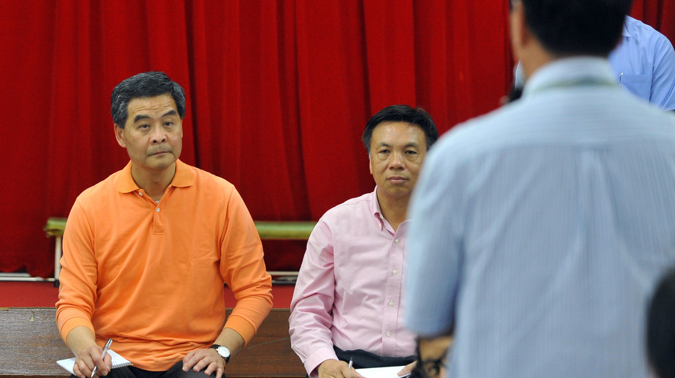 "New Hong Kong Chief Executive Leung Chun-ying visits a Welfare Advancement Association on Monday, a day after taking office. Leung vowed he would ""humbly"" listen to the public, but some critics branded him a lame duck after the restive city's biggest protest in nearly a decade. (AFP/Getty Images)"