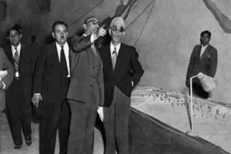 In 1946, Afghanistan's king, Mohammed Zahir Shah (pointing), hired the American engineering firm that built the Hoover Dam and the San Francisco Bay Bridge to construct dams and irrigation canals in southern Afghanistan. He believed the project could transform the arid valley into a fertile and thriving oasis.