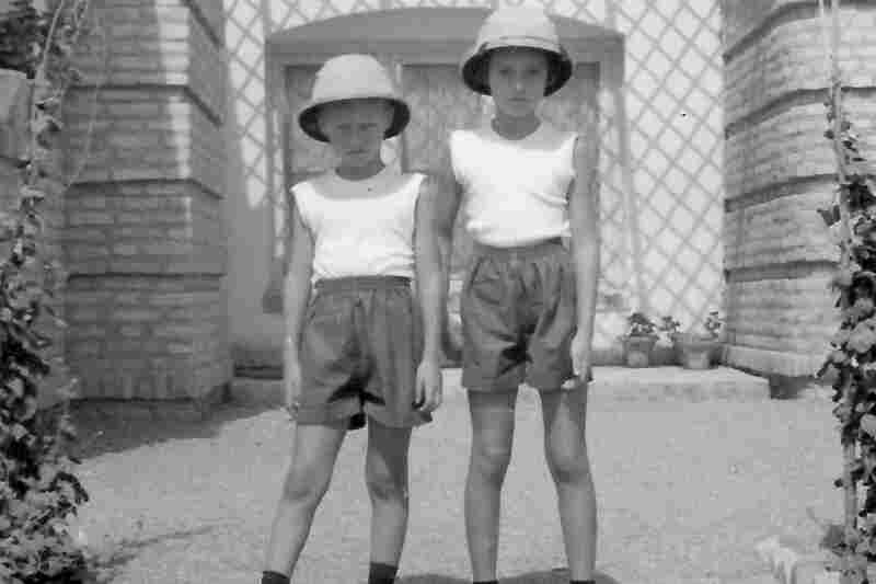 Seven-year-old Lawrence Odle and his 9-year-old sister, Bettina, stand in front of their home in Lashkar Gah in 1956.