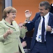 German Chancellor Angela Merkel, German football association president Wolfgang Niersbach and German Interior Minister Hans-Peter Friedrich
