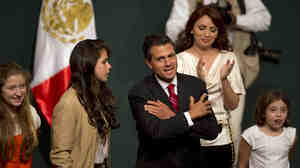 Enrique Pena Nieto and his family celebrated Sunday in Mexico City after he claimed victory in the presidential election.