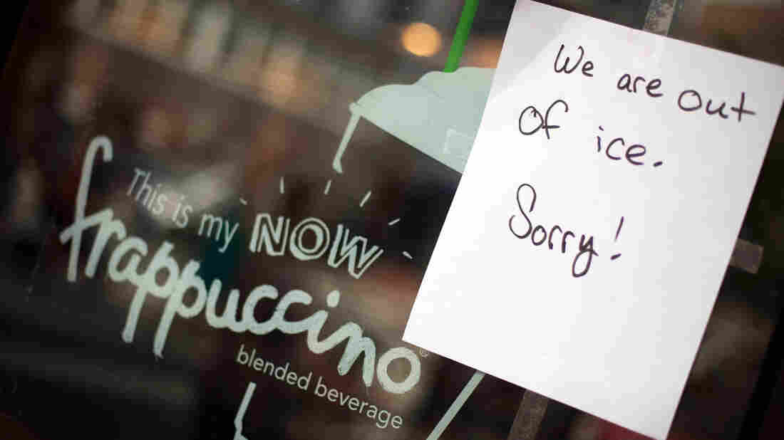 Sign of the times: In Bethesda, Md., a Starbucks breaks some bad news. Ice is in short supply in many places where the power is out.
