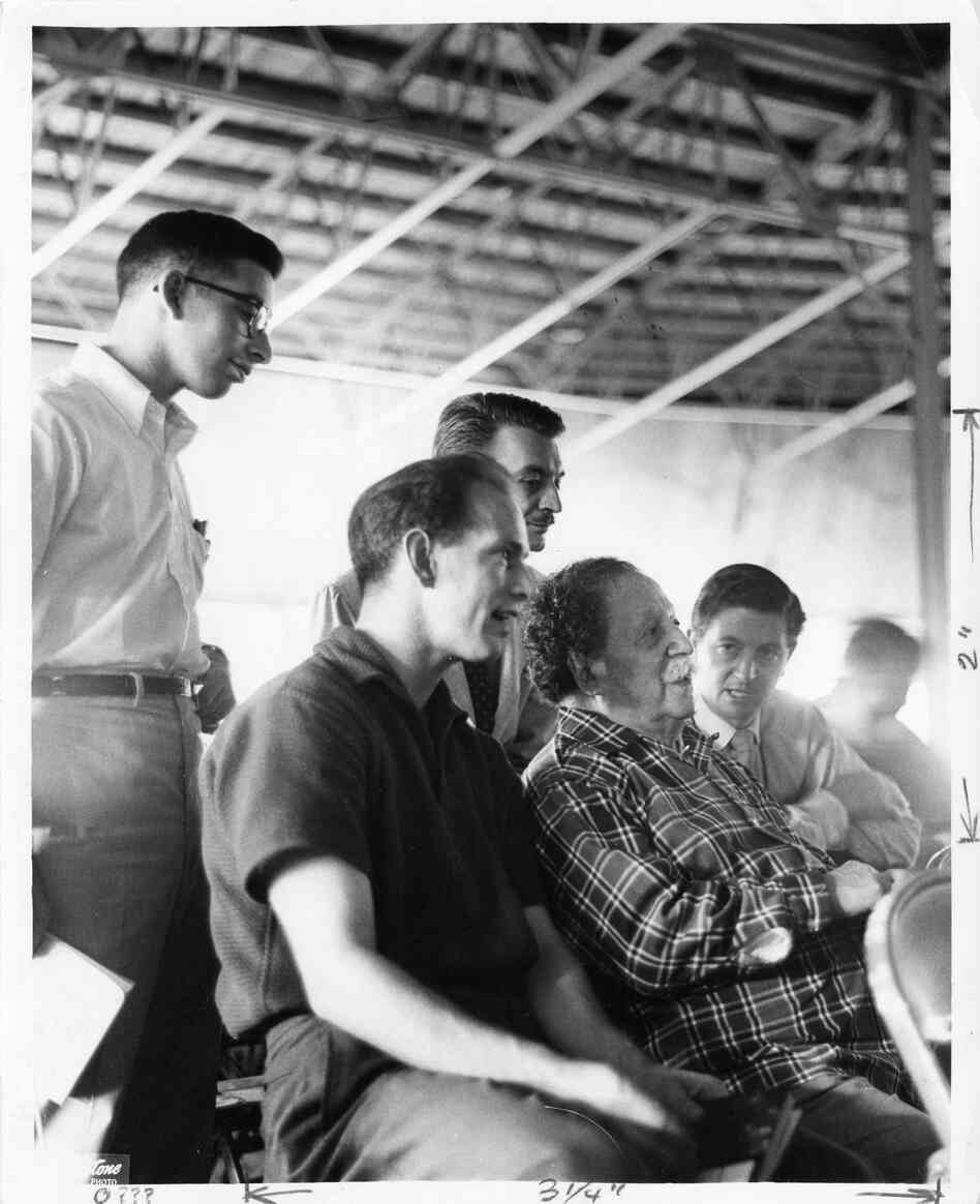 Undated: Conductor Pierre Monteux (in plaid) sits in Tanglewood's famed shed, talking with stude