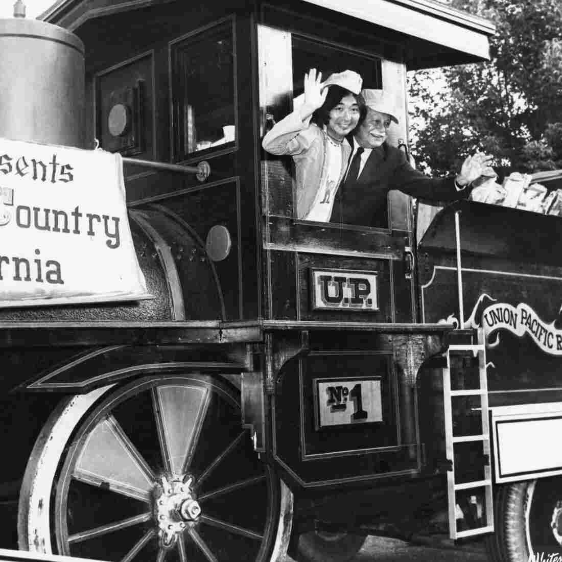 Seiji Ozawa and Arthur Fielder, aboard a train during Tanglewood on Parade, 1975.