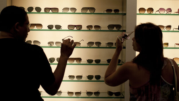 Brazilian shoppers try on sunglasses at a store in Fort Lauderdale, Fla., in March.