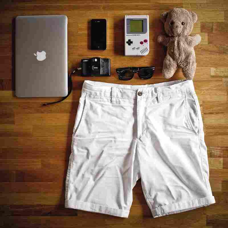 "Will Cheyney, 27, London, design director: ""11"" MacBook Air, Eddy the Teddy, Nintendo Game Boy, Ray-Ban folding Wayfarers, iPhone 4, white chino shorts, Lomo LC-A camera."""