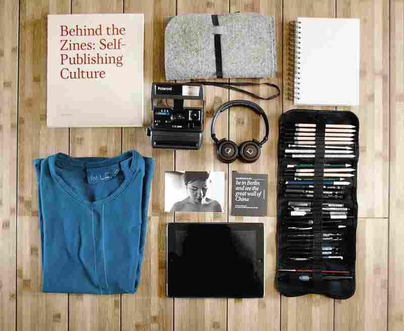 "Manuel Platzer, 27, Austria, digital media: ""... Headphones, Polaroid camera, photo of girlfriend ... drawing tools, iPad, T-shirt handmade by my girlfriend."""