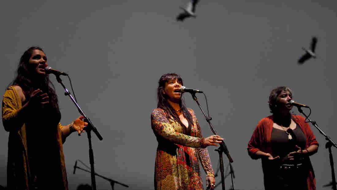 Singers Deline Briscoe, Shellie Morris and Lou Bennett (pictured left to right) perform with Australia's Black Arm Band Company.