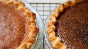 A Northeastern Bakewell Pie (left) and Western Chocolate Raisin Pie cool on author Adrienne Kane's Connecticut kitchen counter.