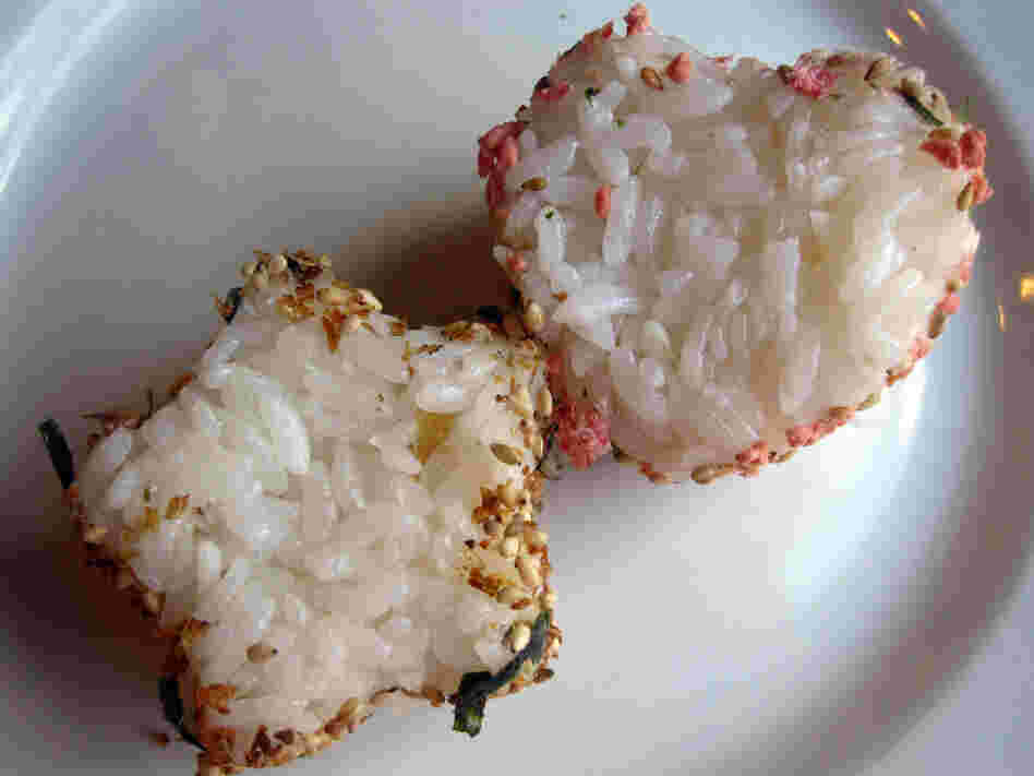 Leftover rice can be pressed into shapes; the sides are rolled in furikake seasoning.